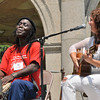 Salem: Mamadou Diop, left drums as Brazilian jazz musician Teresa Ines sings on the Salem Common for the Culture Fest.  photo by Mark Teiwes / Salem News
