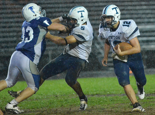 Danvers: Triton's Blaise Whitman carries the ball on a quarterback keeper.  photo by Mark Teiwes / Salem News