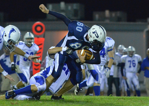 Peabody: Peabody's #80 gains yards and tackled by Danvers player Rick Valles.  photo by Mark Teiwes