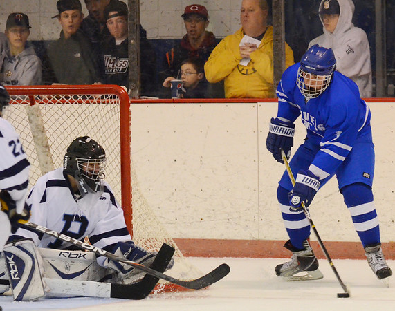 Peabody:  Danvers Patrick McBride gets a close look at the goal covered by Peabody's Derek Savage.  photo by Mark Teiwes  / Salem News