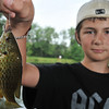 Danvers: Kevin Reidy shows off one of the many fish caught during the Mike Gordon Fishing Derby.   photo by Mark Teiwes / Salem News