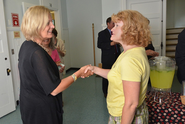 Wenham:  Kathy Harris, left, Director of Student Services and Special Education, is greeted by Jill Romano of Wenham at the School District Offices.  photo by Mark Teiwes /  Salem News