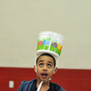 Salem:  Aneudy Espinal, 11, of Salem looks up to catch a ball with a easter egg bucket tied to his head.  This was one many games organized by the YMCA for the Mayor's annual Easter egg event.  photo by Mark Teiwes