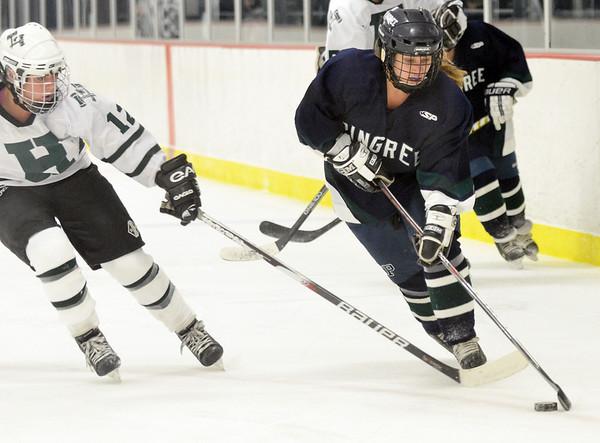 Hamilton: Pingree's Alanna Krowiak, right skates around Hebron Academy's Sarah Markey.  photo by Mark Teiwes / Salem News