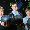 "Peabody: Metro Bowl children's league ""Strike Bombers"" team Peabody's St.  John's sixth graders Ian Luto, left, James Murphy, and Cole Couture.  photo by Mark Teiwes  / Salem News"