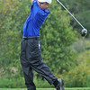 Danvers:  Danvers High School golfer Dan McKenna follows through after teeing off on the 6th hole. photo by Mark Teiwes  / Salem News