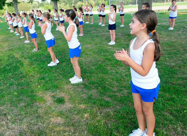 Danvers: Sarah Vancampen, 8, claps in unison with the 3rd and 4th grade cheering team.  The group learns cheers, a half-time show and stunts. photo by Mark Teiwes / Salem News