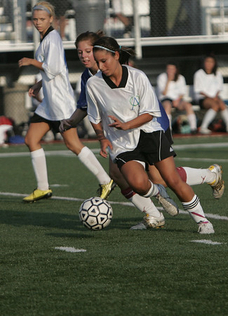 Lynn: Salem High School's Desiree DeLeon dribbles past a defender in the Agganis All-Star Women's soccer classic.   photo by Mark Teiwes  / Salem News