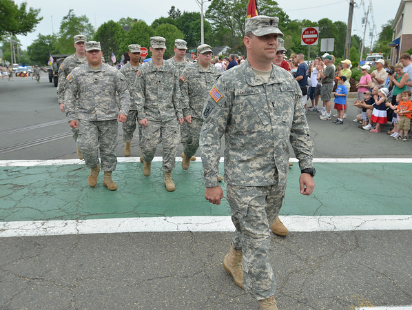 Danvers:  Lt. Mark Gauthier of Peabody leads the 101st Field Artillery, Second Corps Cadets, in the Danvers memorial day parade.  photo by Mark Teiwes / Salem News