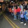Salem:  Kids cheer and flinch as candy is thrown along Derby Street at the15th annual Haunted Happenings Grand Parade. photo by Mark Teiwes / Salem News