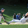 Peabody: St. John's 3rd baseman Keven Barry tags out Bishop Fenwick player Zach Brian.  photo by Mark Teiwes / Salem News