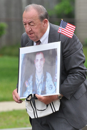 Danvers: Jim George of Danvers carries a photo in memory of SSG Brad Svoboda, who died in 2007 on active duty in Panama serving as a military policeman with the Army.  photo by Mark Teiwes / Salem News