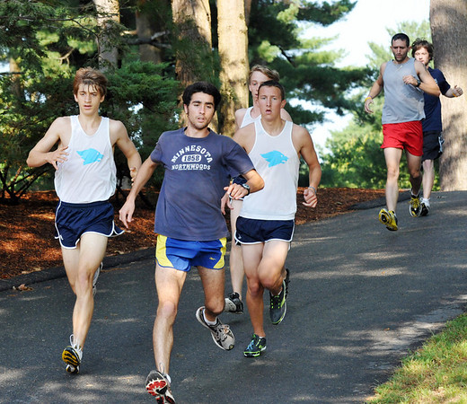 Wenham:  Salem State's Alex DeRosa, center, runs with Gordon's  Andrew Kwiatkowski, left, and Brian Holahan, right, close behind.   photo by Mark Teiwes / Salem News