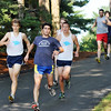 Wenham:  Salem State's Alex DeRosa, center, runs with Gordon's  Andrew Kwiatkowski, left, and Brian Holahan, right, close behind.   photo by Mark Teiwes / Salem News