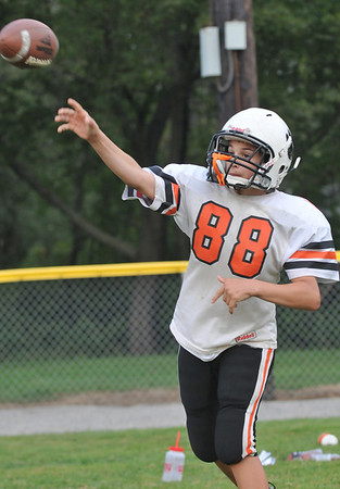 Beverly: Austin Beaulieu, 13, makes a pass during practice. photo by Mark Teiwes /  Salem News