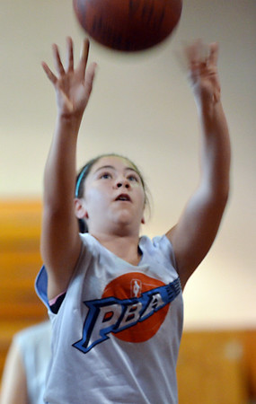 Peabody: Courtney Nadeau, 13, makes a free throw.  photo by Mark Teiwes / Salem News