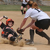 Beverly: At the Courtney Corning Memorial Softball Tournament Bishop Fenwick's Katherine Melanson tags out Beverly player Jenn Gallione. photo by Mark Teiwes / Salem News