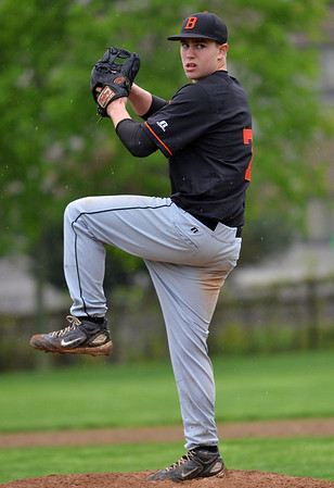 Beverly:  Beverly pitcher Cam Rogers winds up for a pitch. photo by Mark Teiwes / Salem News