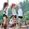 Topsfield: 7th grade cheerleaders work on a routine during a practice for the upcoming football season.  190 girls participate in the1st-8th grade Masconomet Youth Cheeleading program.  photo by Mark Teiwes /  Salem News