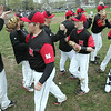 Marblehead: Marblehead High School baseball team celebrates after a successful inning on the field.  Mark Teiwes / Salem News