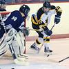 Peabody: Bishop Fenwick's Nick Amirault, right, looks for a shot on Trinity Catholic goalie George Wells.  photo by Mark Teiwes  / Salem News