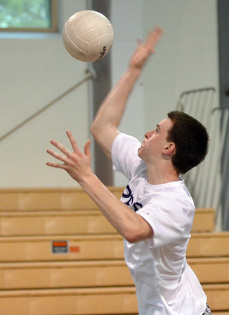 Danvers: St. John's Prep captain Sean Mackinson serves against Andover.   photo by Mark Teiwes / Salem News