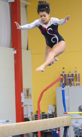 Beverly: Ipswich High School junior Sidney Hardie leaps during her beam routine.  photo by Mark Teiwes / Salem News