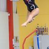 Beverly: Ipswich High School junior Sidney Hardie leaps during her beam routine.  photo by Mark Teiwes / Salem News