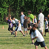 Salem: Kids warm up with sprints at the Salem youth football clinic.  photo by Mark Teiwes / Salem News