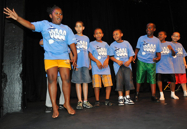 Salem:  During a family night for the Salem Community Childcare School Age Program a dance group performs with Eboni Williams, left, showing off a dance move.  photo by Mark Teiwes / Salem News