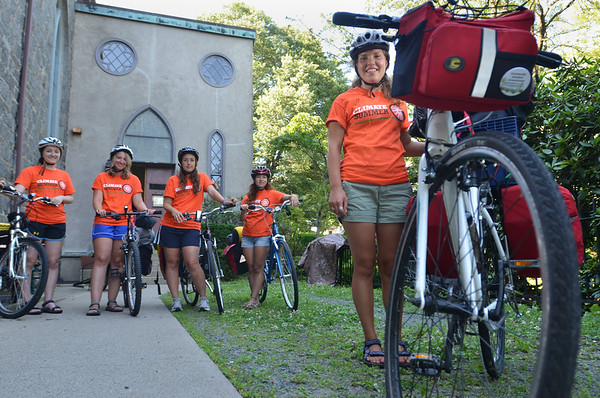 Salem: Sam Burke of Philadelphia, left, Alyssa Henry of Seattle, Ale Dominguez of Weston, Fla., Eliza Sherpa of Ithaca N.Y., and Sara Hopps of Beverly are part of the New England Climate Summer program bicycling around Massachusetts leaning about sustainable energy projects.  photo by Mark Teiwes / Salem News