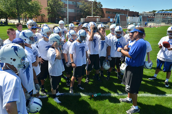 Danvers: Vasity head coach Sean Rogers, right, speaks with his players on the first day of practice for the Danvers High School football team.   photo by Mark Teiwes /  Salem News