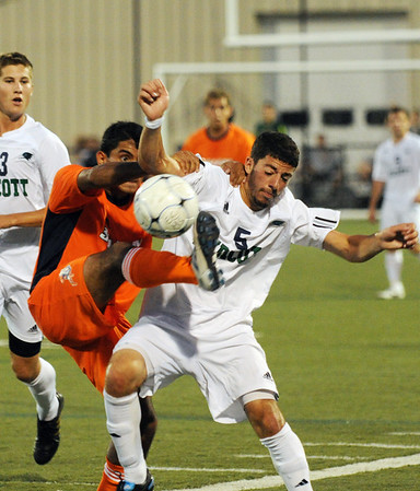 Beverly: Salem State Vikings player Rafael Santos, left, fouls Endiott's Brett Longobucco.  The two teams fought back and forth tying 1-1.  photo by Mark Teiwes / Salem News