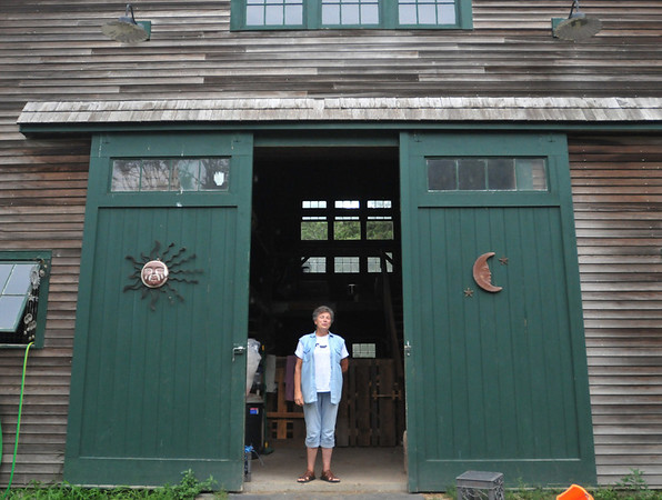 Ipswich:  Sister Pat Rolinger, executive director of the<br /> The Cuvilly Arts Center stands in the door of a barn used for nature-based educational programming.  photo by Mark Teiwes / Salem News