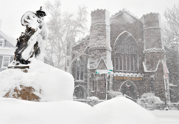 Salem: A statue outside the Salem Witch Museum is plastered with snow.  photo by Mark Teiwes / Salem News