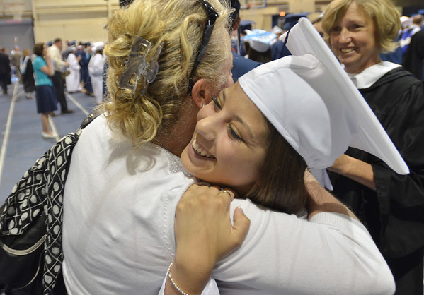 Peabody: Gymnastics coach and teacher Jeanne Flynn gives Vanessa Avola a big hug celebrating the $6000 of scholarships she has earned for Salem State to study nursing.  photo by Mark Teiwes / Salem News