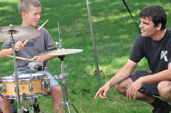 Salem: John Ginley, left gets a drum set lesson from drummer Leo Ciaramitaro. The Salem Jazz and Soul Festival includes music education and proceeds benefit music education programs on the North Shore.    photo by Mark Teiwes /  Salem News