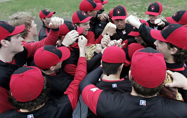 Marblehead: Marblehead High School baseball team comes together before an inning.  Mark Teiwes / Salem News