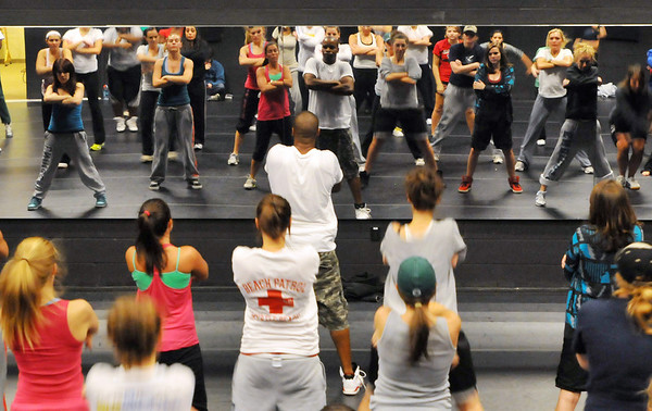Beverly: Devin Woolridge, center, of the Phunk Phenomenon Urban Dance Theater, leads a workshop at Endicott's Performing Art Center.  photo by Mark Teiwes / Salem News