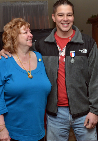 Danvers: Sgt. Scott Henshaw stands with his proud mother Gail Henshaw.   She said that it is bitter-sweet since he is only able to visit home for ten days and she only sees him about every two years.  photo by Mark Teiwes / Salem News