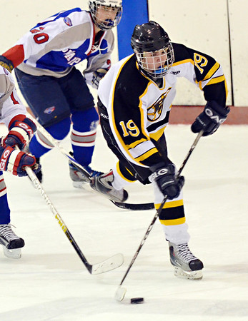 Peabody: Bishop Fenwick's Nick Amirault looks for a shot followed by Swampscott defence. photo by Mark Teiwes / Salem News
