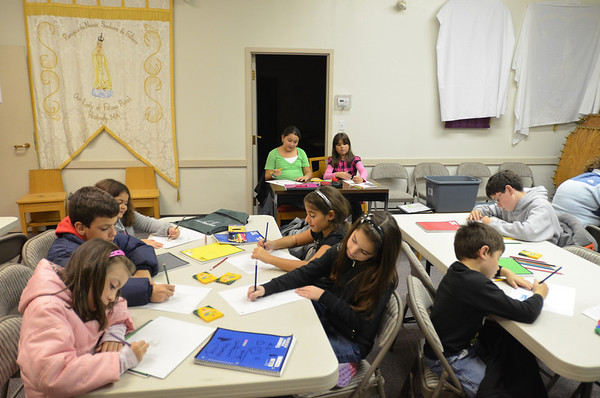 Peabody: Students work on a drawing project in Portuguese class at Our Lady of Fatima Church. photo by Mark Teiwes / Salem News