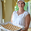 Ipswich: Antigoni Woodland, co-chair of the Ipswich Greek Festival and Clambake, holds a tray of baklava ready for the weekend festivities.  photo by Mark Teiwes / Salem News