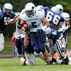 Hamilton: Triton High School varsity football player Derek Paquette sprints into open space after finding a gap in Hamilton-Wenham's defensive line.  photo by Mark Teiwes / Salem News
