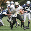 Hamilton:  Bishop Fenwick's Rufus Rushins bursts through the tackle of Hamilton Wenham's Pete Duval.  photo by Mark Teiwes / Salem News