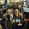 Salem:  Emotions run high as students line up prior to the Salem State University grad school commencement ceremony.  photo by Mark Teiwes / Salem News