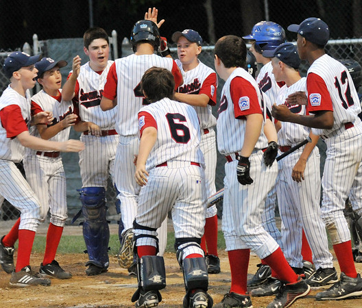 Beverly:  The Swampscott team welcomes Ryan January after his home run hit at the Little League all-star state sectional game Mark Teiwes / Salem News