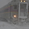 Beverly: A commuter train on its way to Boston rolls through the snow.  photo by Mark Teiwes / Salem News