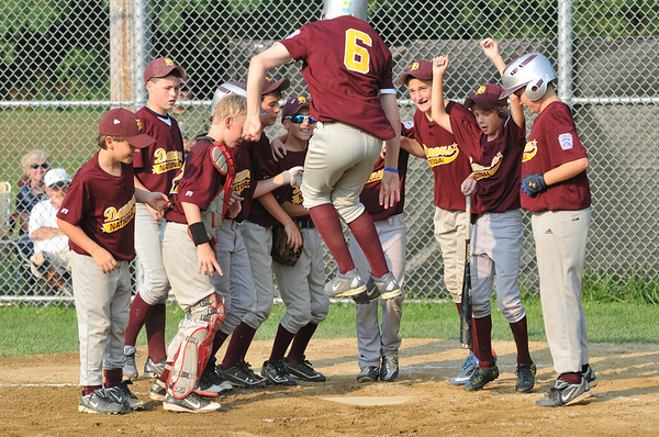 Tewksbury: Danvers National players celebrate Jack Anderson's home run in the first inning.  photo by Mark Teiwes / Salem News