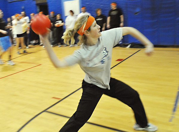 Beverly:  Briscoe Middle School reading teacher Beth Kerchner takes aim at a team of students at dodge ball game to raise money for the families who lost their home in a fire in Beverly last month.  photo by Mark Teiwes / Salem News